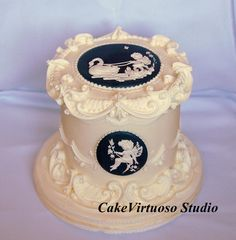 English overpiping style cake with pressure pipied cherubs