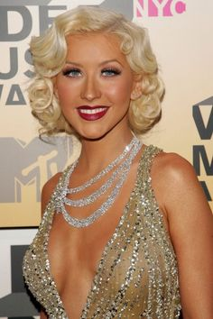 Another Christina Aguilera pin! Shorter curls reminiscent of Marilyn Monroe's signature hairstyle. Gorgeous!