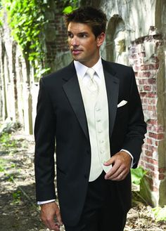 black and all white tux for the groom