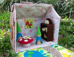Bubby Makes Three: Make a Fabric Dollhouse   Dimensions are smaller than I want, but cute and lots of ideas.