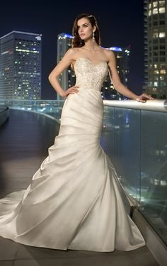 Strapless wedding dress features a trumpet silhouette from Essense of Australia (Style D1459)