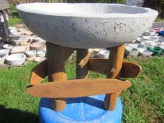 """21"""" papercrete bowl on rustic stand."""