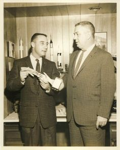 Gus Grissom, is seen showing his award that he received from the U.S. Junior Chamber Of Commerce for being one of the ten outstanding young men of 1961.