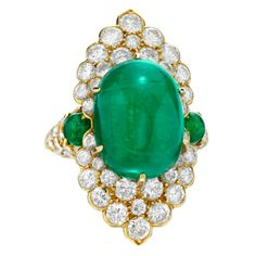 Van Cleef & Arpels, An Emerald and Diamond Ring, set to the center with a cabochon emerald within a navette-shaped surround, set with circular-cut diamonds, to the similarly-set shoulders, mounted in gold, signed Van Cleef & Arpels, with French assay marks, numbered 25869. 45k USD