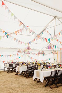Banners are a cute idea, especially for a beach or nautical themed wedding.  Could use string lights with a few banners of wedding party colors (find some print fabric to match color theme) hanging randomly between lights.