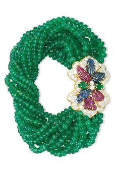 An EMERALD, RUBY, SAPPHIRE AND DIAMOND BRACELET ~ Bracelet designed as twelve rows of slightly graduated emerald beads, gathered by a pavé-set diamond clasp applied with carved sapphires, rubies and emeralds, mounted in gold, necklace 47.0 cm, bracelet 18.5 cm