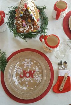 a fun little Santa-inspired table that will keep that Christmas feeling going throughout the day. Hot cocoa will be served in these adorable vintage-style Santa mugs.