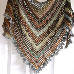 Gypsy shawl --- my style.  I will be making something like this for my daughter. --- So, to make this is easy, start from the bottom building blocks all the way up, changing colors and add a fun trimming.