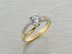 Zlatý dámsky prsteň vyrobený zo 14 karátového zlata osadený  zirkónmi.