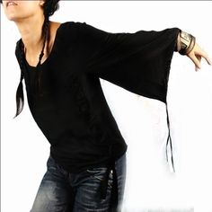 black blouse <><><> For those of you who're  fans, this looks like something Patti Labelle  would do !  LOL
