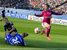 Hit and Run - Lara Dickenmann (R) of Olympique Lyon avoids a collision between FFC Frankfurt's goalkeeper Desiree Schumann (26) and Saskia Bartusiak during their Women's Champions League final soccer match at the Olympic Stadium in Munich, Germany.