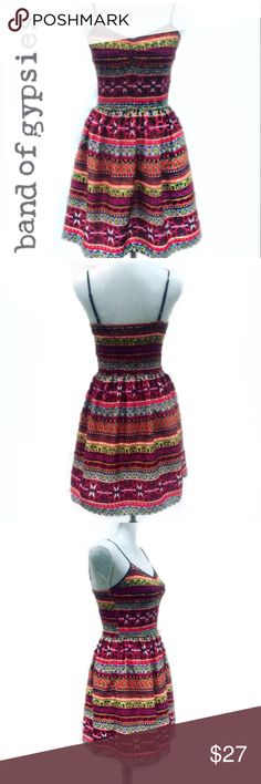 """Band of Gypsies Printed Sundress Adorable! Multi-colored rich toned print and pattern. Adjustable spaghetti straps. Elasticity and stretch at top of dress. Measures 25"""" from base of armhole to hem. 100% Polyester with a bit of a silky feel on the skirt. Fabric condition is like new. This dress has pockets!  Band of Gypsies Dresses"""