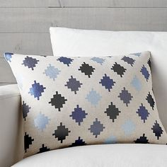 Diamond motifs derived from Navajo textiles pattern this natural cotton embroidered pillow with a beautiful range of blues. Pillow reverses to solid. Our decorative pillows include your choice of a plush feather-down or lofty down-alternative insert at no extra cost.
