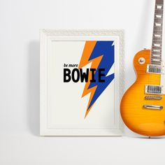 BE MORE BOWIE - BLUE  Part of our Rock Slogans range, Bowie in blue and orange, 1 of 4 colour ways of this design - check out our website for the others, colour combinations for every interior style.