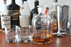 Ours Decanter Set. Each set includes an Ours decanter and two - 8 ounce low-ball glasses with His/Hers, His/His, or Hers/Hers hand-engraved on them.  Absolutely the best gift for weddings, showers, housewarmings and for couples period. By Love & Victory.