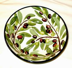 Olive vegetable bowl, a current pattern painted by Geoff Graham in Vallejo, California at Cinnabar Ceramics. You can google the Cinnabar Ceramics Website if you want to know more.