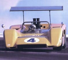 Bruce McLaren in his McLaren Can-Am race car.