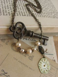 Shabby Chic Steampunk Key Necklace -antique skeleton key and watch face assemblage-. $40.00 USD, via Etsy.