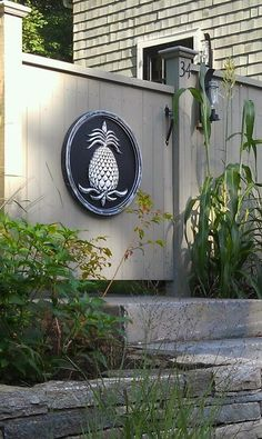 Pineapple Plaques on the patio or garden date shows hospitality and says Welcome!