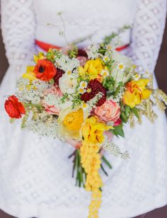 Red and yellow pee wee bouquet, Gorgeous vibrant colours in this brides bouquet. #flowers #bride #colourful