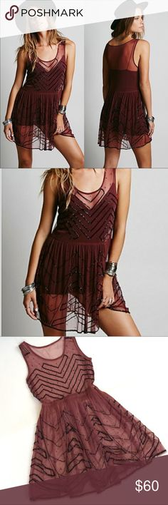 Free People Beaded Slip Dress LOVE this Slip dress!!  Soo beautiful! Missing maybe 1-2 beads.. excellent condition!  These dresses are best worn over a bodysuit, tank top, or solid slip dress.  Check out my closet for more Free People! Free People Dresses