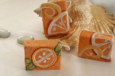 Gorgeous examples of needle felting on felted soap.