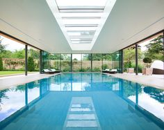 Indoor Swimming Pool Design Ideas Equipped With White Ceiling Unit With Best Glass Panel Plan Unit