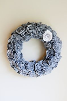 Grey Felt Rosette Handmade Wreath by EmbellishedLiving on Etsy, $55.00. Just figured out the rosettes I think I can do this cheaper than $55 easily. It's so cute!