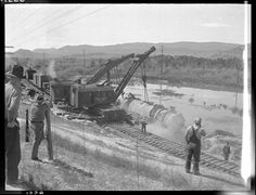 """Date: June 1935  Location: Willow Creek, MT Photographer: Ron V. Nixon Railroad: Northern Pacific Railway Caption: """"Engleside Spur derailment of NP 2655, Class A-2 and Train X2655E/652's which derailed because of washout due to cloudburst. Wreckers now have locomotive 2655 back up on track."""" --- USA"""