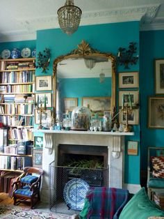 See this latest pic on Ben Pentreath's blog: books don't HAVE to be orderly on a bookshelf, especially if there are other bold pieces/colors in the room. I live with my books and pull them out and sometimes haphazardly put them back on the shelf. I don't want to pull all of my bks to the edge of the shelf one by one! It seems fake to me.