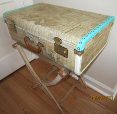 Altered suitcase by Corinne Stubson  http://www.glitz-oh.com  Covered with newspaper fragments from an 1880 newspaper, painted edges with acrylic paint.