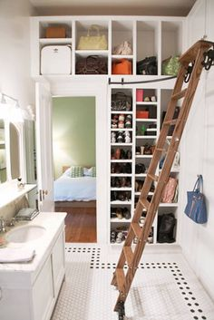 Loving the built ins and the ladder, but not in the bathroom! Wouldn't steam cause damage?