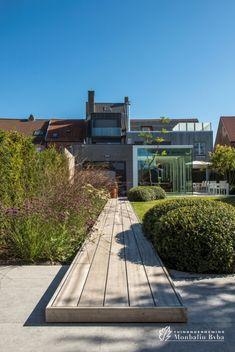Aangelegde tuinen door tuinonderneming Monbaliu - Stadstuin met open visie