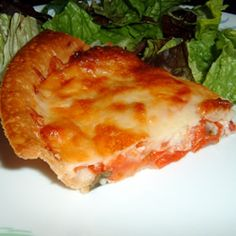 Tomato Pie I Allrecipes.com    I have made this many times for lunch or as a side at a family reunion.  It is good warm or at room temperature.  Yummy.