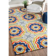 This beautiful modern rug is hand hooked with easy to clean polypropylene for both indoor and outdoor use.
