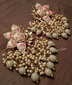 Pearl lotus earrings from For price and other details DM Indian Jewelry Earrings, Indian Jewelry Sets, Silver Jewellery Indian, Jewelry Design Earrings, Indian Wedding Jewelry, Ear Jewelry, Jewelery, Silver Jewelry, Silver Earrings