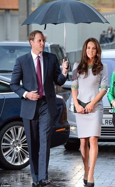 """The Duke and Duchess attending the U.K. Premier of """"African Cats"""". Kate in a Matthew Williamson peplum dress.  I can't believe that on Sunday they will have been married a year already!"""