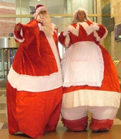 Santa and Mrs Claus on stilts  Alan Casey Entertainment Agency
