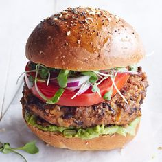 Salsa and some pantry staples give this vegetarian bean burger recipe tons of flavor. We use crushed tortilla chips to bind the burgers together, making them a great vehicle for using up those crumbs that inevitably fall to the bottom of the bag. Vegetarian Dinners, Vegetarian Recipes, Healthy Recipes, Healthy Foods, Healthy Heart, Protein Recipes, Healthy Dinners, 400 Calorie Dinner, Black Bean Burgers