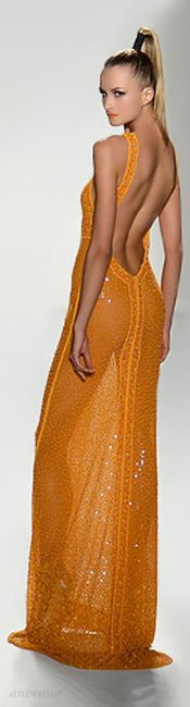 Joanna Mastroianni.- not sure how 'substantial' this golden orange evening gown is :-)