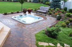 bullfrog hot tub recessed in stone patio - Google Search