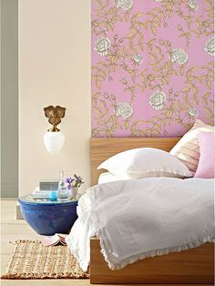 Create the look of a headboard with wallpaper: http://www.bhg.com/rooms/bedroom/headboard/cheap-chic-headboard-projects/?socsrc=bhgpin092414wallpaperstatement&page=6