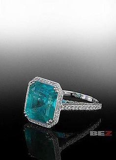Emerald center stone in a knife edge pave mounting.  By Bez Ambar.  Available at Alson Jewelers.