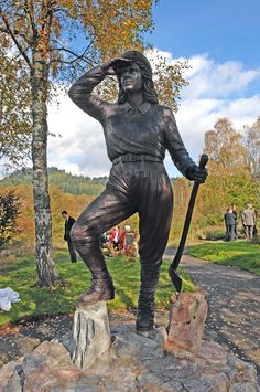 """Memorial to the WLA Lumber Jills. Bronze, life-size statue carved by Malcolm Robertson.  """"She gazes out over the surrounding forest in Queen Elizabeth Forest Park near Aberfoyle, Stirling, Scotland."""""""