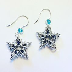 Star shape Chainmaille earrings, look a lot like snowflakes too. perfect for winter time and Christmas. Made with silver rings , and ear hooks are silver wire 20 gauge with a blue crystal bead. Blue Beads, Blue Crystals, Crystal Beads, Star Shape, Chainmaille, Winter Time, Snowflakes, Silver Rings, Jewelry Making