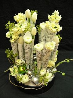 Love this beautiful arrangement of winter white flowers wrapped in sheets of music!