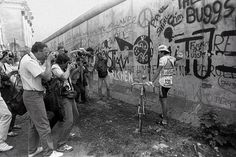 1987: The Tour has made occassional forays into Germany as well. With Berlin celebrating its 750th birthday, the tour began in the divided German city that year. Here, the Colombian rider Luis Herrer poses in front of the Berlin Wall.