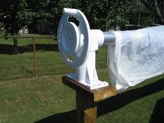 DIY Above ground pool stationary solar reel cover  ~  Making smart use of a deck mount reel when you have no deck!  You could go simple, or dress it up.