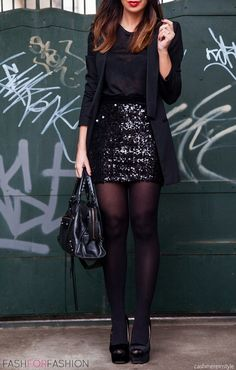 Black sparkly mini skirt with a black blouse worn with black tights and heels.