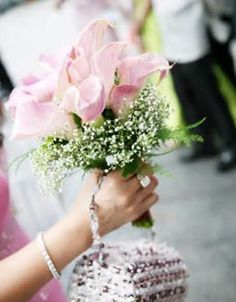 Love this cala lily bouquet... but purple calas and the bridesmaids can carry just baby's breath